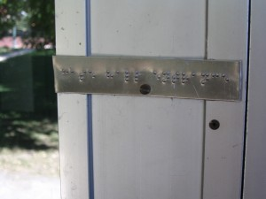 Braille label at the front door of Case Hall at Baker University