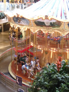 A two-story carousel is right next to the play area at Oak Park Mall.
