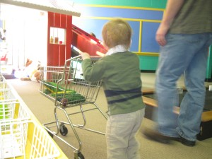 Peanut pushes his shopping cart full of corn through the farm.