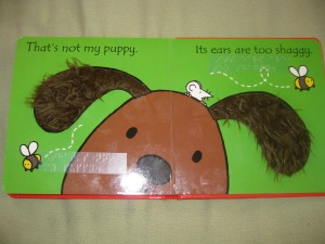 An interior set of pages of the That's not my puppy . . . book.  This one features a puppy whose ears are too shaggy.