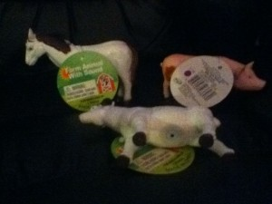 Picture of our three toys:  horse is on the left rear, pig on the right, and sheep laying down at center.