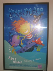 A poster advertising the Under the Sea Adventure exhibit at Crown Center