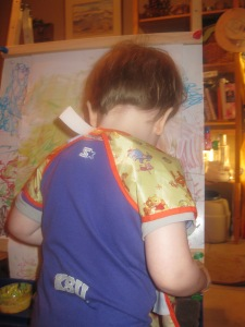 Peanut painting at his easel.