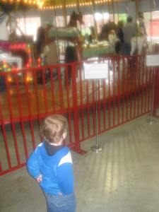 Peanut in front of the 1913 carousel.