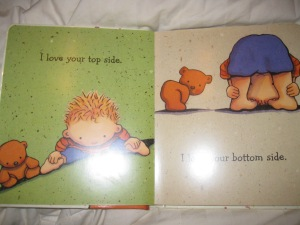 """One of the inside pages of the book, with """"I love your top side"""" on the left page, and """"I love your bottom side"""" on the right."""