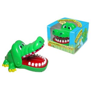 Photograph of the Crocodile Dentist game, both in and out of its box.