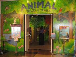 A photograph of the brightly-painted entrance to the Animal Tales & Trails Exhibit.