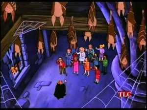 A still from the episode.  Phoebe's Dad is in a red jacket at left facing Ms. Frizzle.