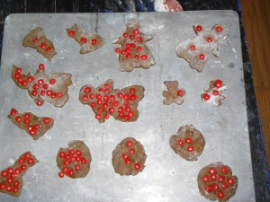 Cookies Peanut decorated, pre-baking.  Yes, it is a GOOD thing to have that many cinnamon imperials on them!  Yum!