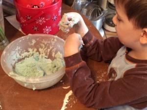 Peanut mixes his blue play dough.