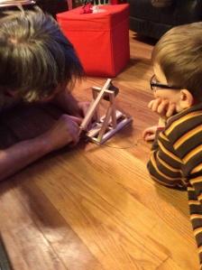 Efrit and Peanut work the trebuchet.