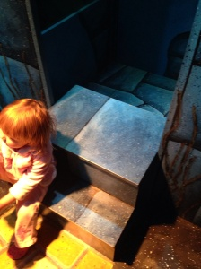 Sprout on the uneven stairs out of the Wicked Witch's castle.