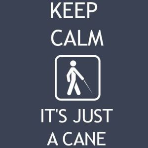 """White block letters on a blue background read, """"Keep Calm It's Just a Cane.""""  A white square surrounds a stick-figure man using a long white cane at the center."""