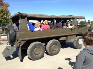 Our friends head out to the pumpkin patch in the army transport.