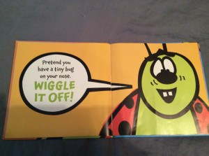 "One of the inner pages of the book.  The lady bug is on the right page, and the left page instructs the reader to ""Pretend you have a tiny bug on your nose.  WIGGLE IT OFF!"""
